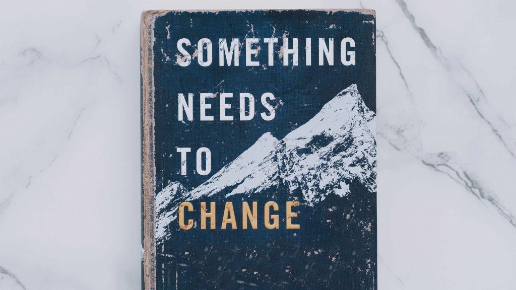книга с надпис Something needs to change
